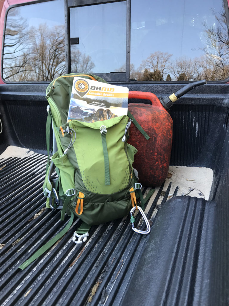 My backpack and extra fuel in the truck bed.