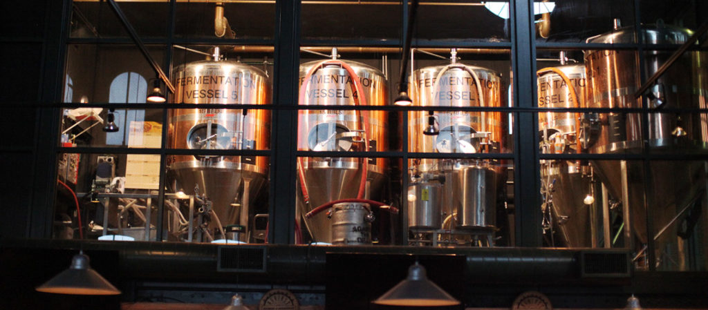 Copper beer tanks in a pub brew room.