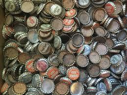 Beer bottle caps in a pile.