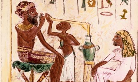 Ancient Egyptians slurping bread beer.