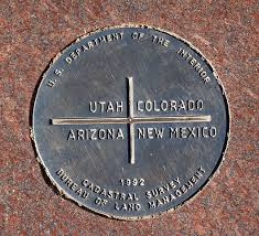 The Four Corners Monument is placed where Arizona, New Mexico, Colorado, and Utah meet.