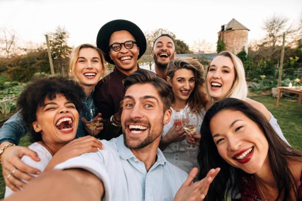 Group of people taking a selfie