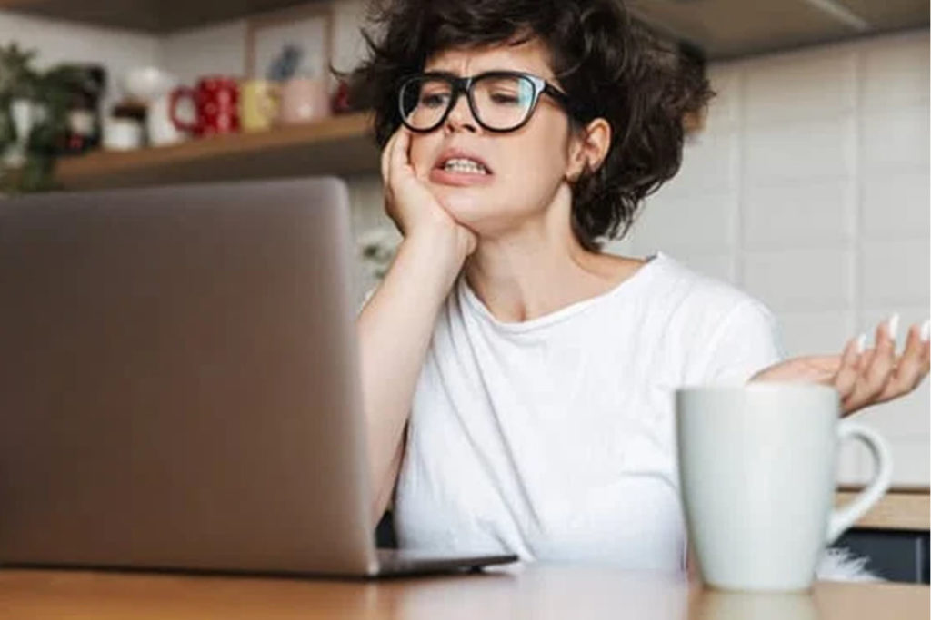 Woman frustrated at her computer